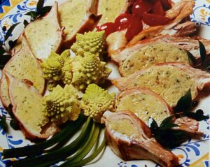 Manfredonia in tavola con pancetta d'agnello ripiena alle erbe aromatiche